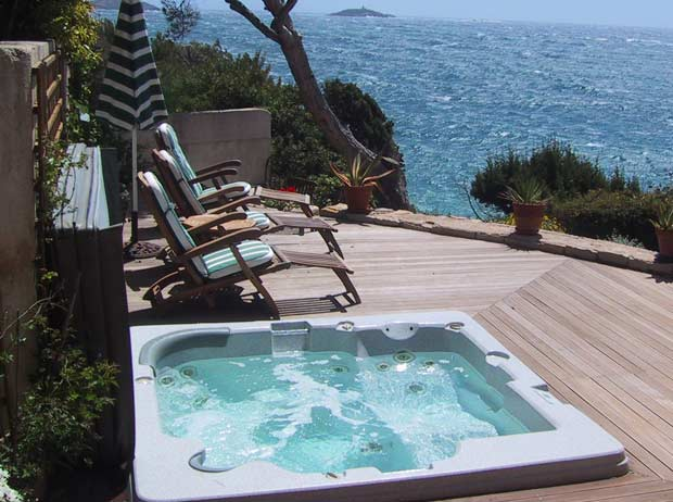 the cost of heating a hot tub a house by the park. Black Bedroom Furniture Sets. Home Design Ideas